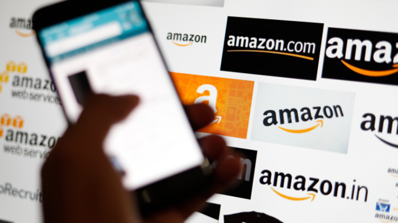 Mandatory Credit: Photo by RITCHIE B TONGO/EPA-EFE/Shutterstock (9859086h) An online shopper browses shopping deals from the Amazom mobile app in Taipei, Taiwan, 05 September 2018. Amazon.com Inc. has become the second publicly traded US company to reach one trillion US dollars in market value. Last month Apple Inc. was the first company to be valued at 1 trillion US dollars. Amazon.com Inc is 2nd US company to reach 1 trillion dollar market value, Taipei, Taiwan - 05 Sep 2018